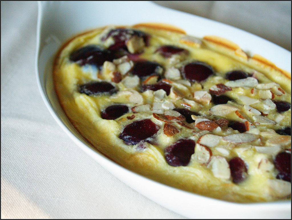 An image of the clafoutis cake, a vanilla base with cherries and almonds