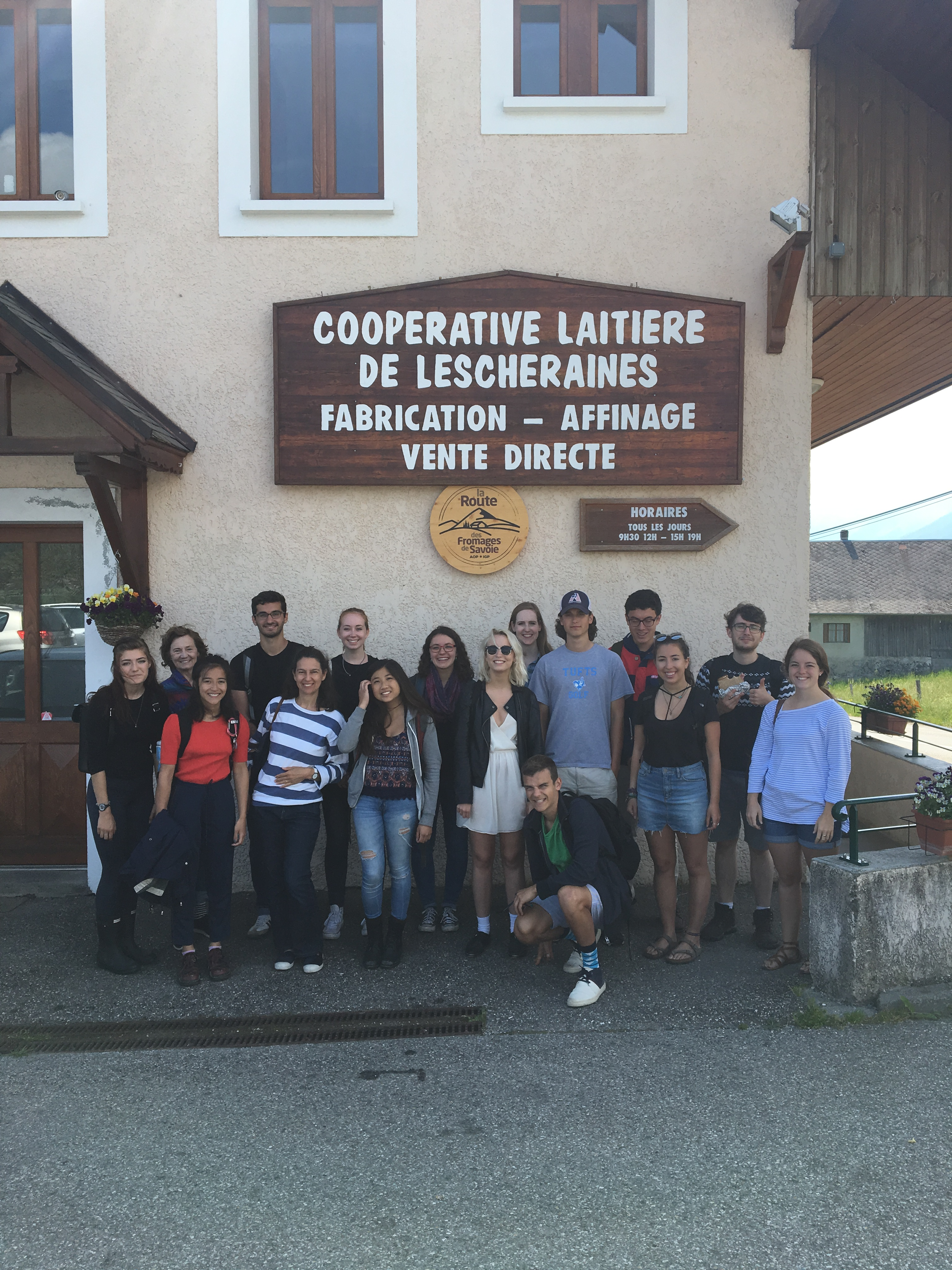 A group of students standing together in front of the Cooperative laitiere de Lescheraines