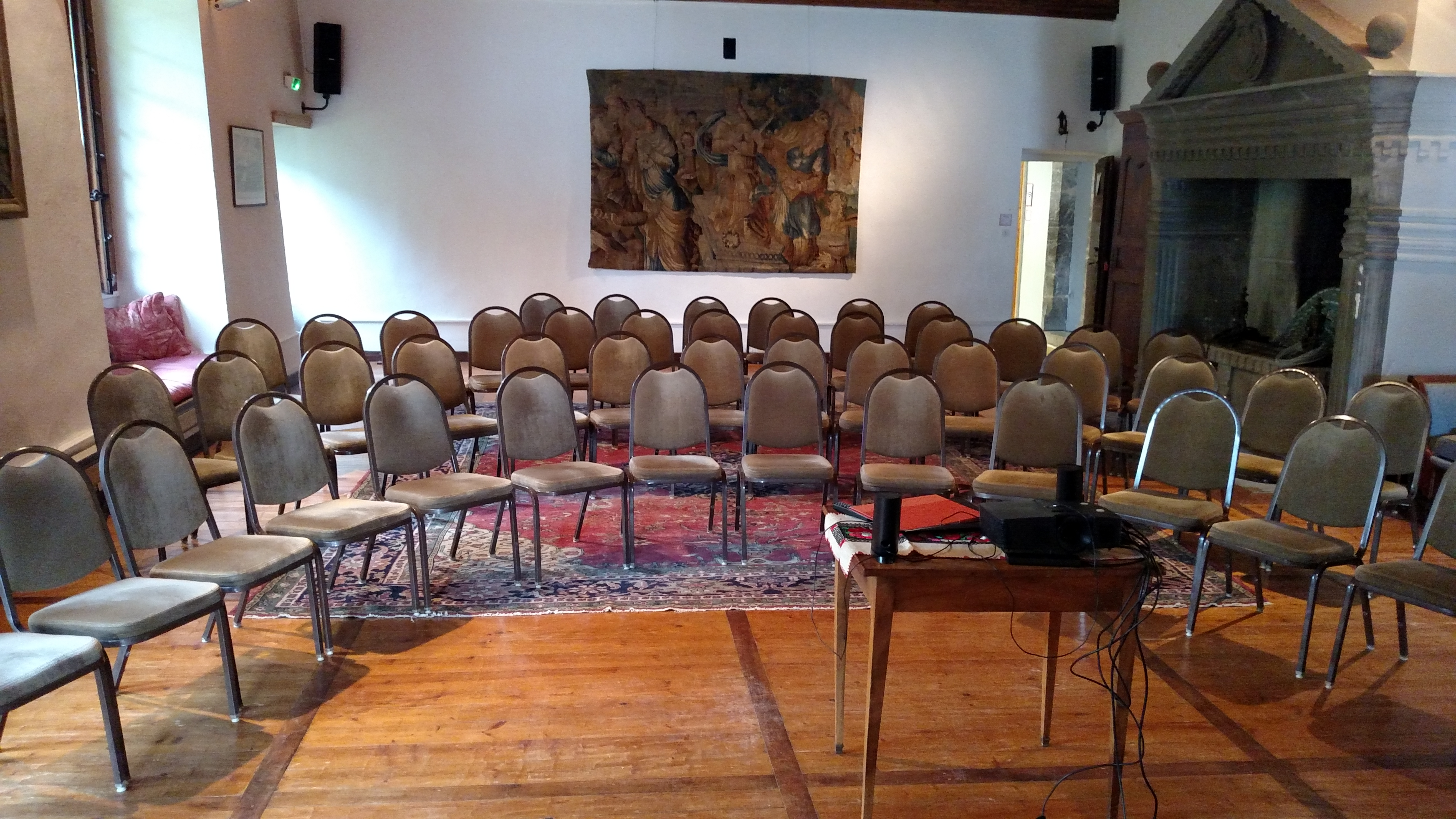 MacJannet Hall with empty chairs set up in a semicircle for a meeting